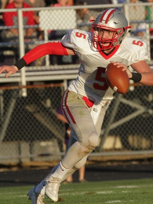 Shelby's Brennan Armstrong looks for an opening at Lexington High School on Friday night.