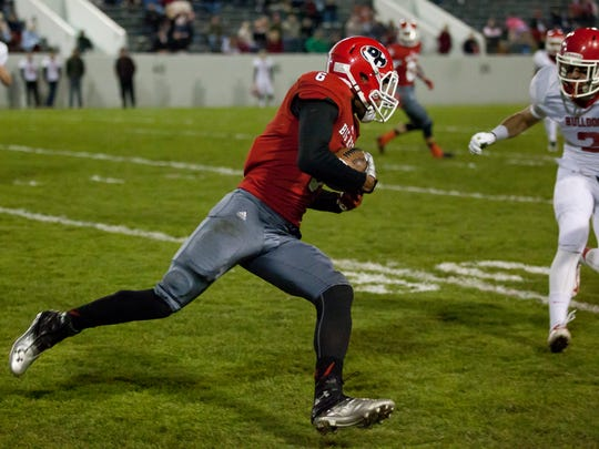 Port Huron senior Bobby Wright runs the ball down field Friday.