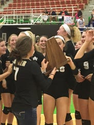 Archer City celebrates its five-set victory over rival