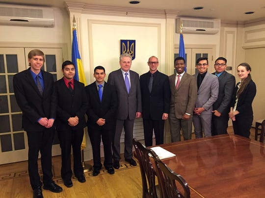 From left: NMSU Model U.N. members Connor Schultz, Marcus Sanchez, Joseph Cairns, Ukraine's Ambassador to the U.N. Voldymyr Yelchenko, NMSU Model U.N. faculty adviser Neal Rosendorf, DeLorean Forbes, Ismael Torres, Ricardo Serrano and Hannah Fort.