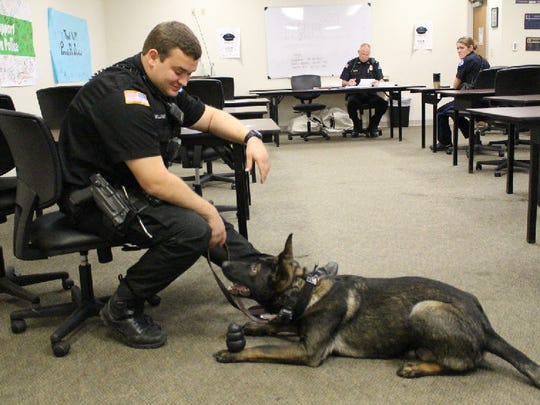 Pensacola Police Department K-9 Foster and his trainer, Officer Brandon Williams, pose for a photo.