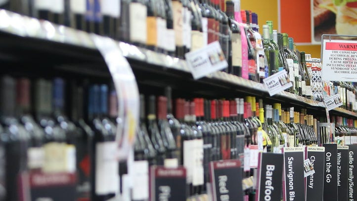 Quinn Gee makes her way down Walmart's wine aisle at