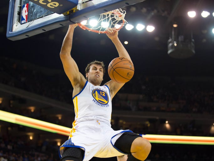 Golden State Warriors center Andrew Bogut (12) dunks the ball against the Los Angeles Lakers during the third quarter at Oracle Arena.