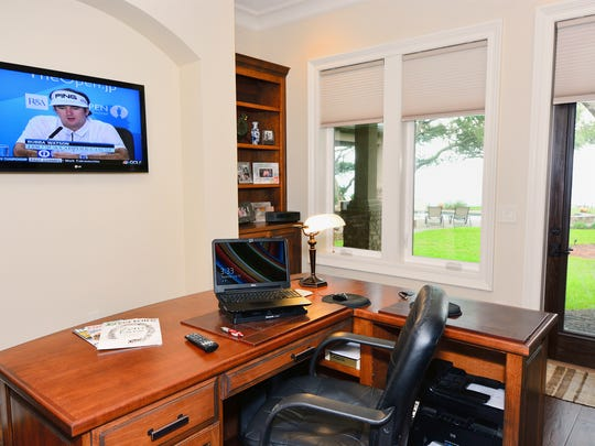 The Walter home office allows technology to be at their fingertips to get work done, while still keeping an eye on other areas of the home.