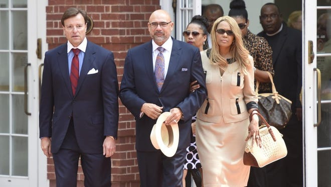 State Rep. Joe Armstrong, with his wife, LeTonia, leaves the Howard H. Baker Jr. U.S. Courthouse on June 19, 2015, after an initial hearing on charges of tax evasion and fraud. At left is attorney Gregory P. Isaacs.