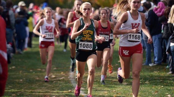 West Lafayette's Kristen Johnson, left, and Benton Central's Cara Hasser pace the pack during the cross country regionals Saturday, October 17, 2015 at the Tippecanoe Amphitheater.