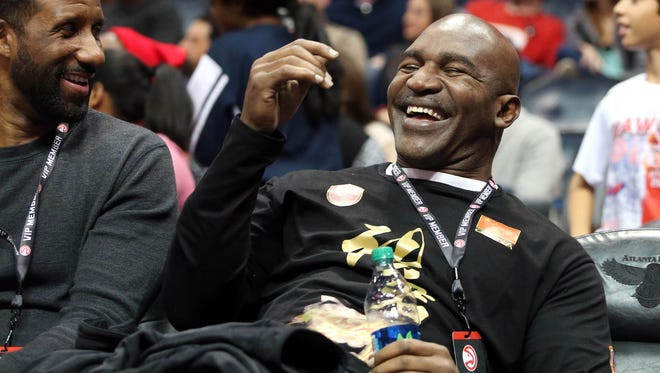 Retired boxer Evander Holyfield reacts to entertainment at an Atlanta Hawks game Jan. 21, 2015.