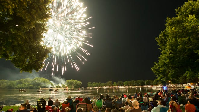 A large crowd gathers at Menominee Park to see the Oshkosh fireworks display.