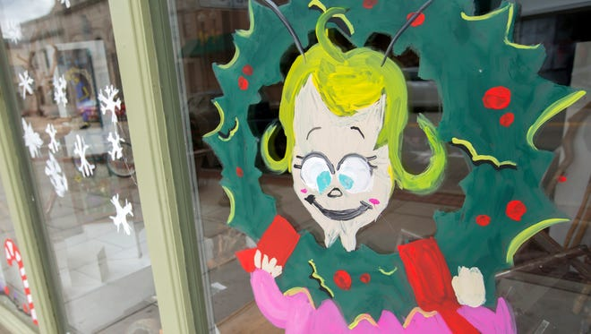 What would Whoville be without Cindy Lou Who? Art students from Oshkosh Area School District painted Whoville scenes on downtown storefront windows in Oshkosh on Monday, Oct. 30, 2017, preparing for the holiday season.