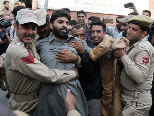Indian police detain activists of separatist groups during a protest in Srinagar on Oct. 6, 2017. The separatist leaders had called for protests against the braid-chopping incidents in Indian Kashmir.