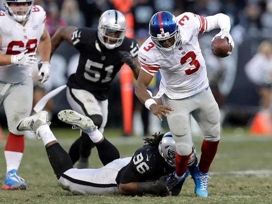 Oakland Raiders defensive end Denico Autry (96) sacks New York Giants quarterback Geno Smith (3) during the second half of an NFL football game in Oakland, Calif., Sunday, Dec. 3, 2017. (AP Photo/Marcio Jose Sanchez)