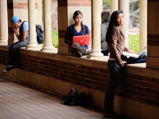"""Students take a break at Royce Hall on the campus of UCLA. Joe Mathews deems the facility's namesake as a California philosopher whose focus spanned ideas """"big and wide as his home state itself."""""""