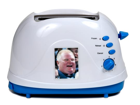 "If boring phone selfies aren't enough, there's the ""Selfie"" Toaster, demonstrated here with an image of Rob Ford."