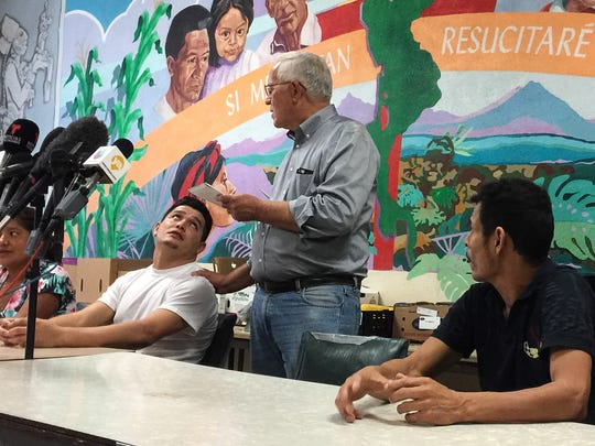 Cristian, an immigrant from Honduras, is comforted by Ruben Garcia of Annunciation House on Monday at Casa Vides, 325 Leon St., after telling how he was separated from his daughter. Monday was her 10th birthday. Melvin, also of Honduras, listens.