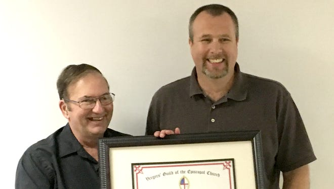 Mike Stitt, left, accepts a certificate of recognition from Michael Rhodes, senior warden of St. Andrew's Episcopal Church.