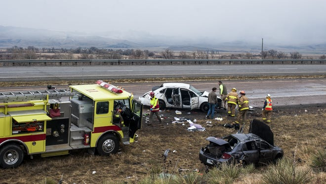 First responders collect information at the scene of two unrelated accidents about three miles south of Cascade on I-15 on Friday.