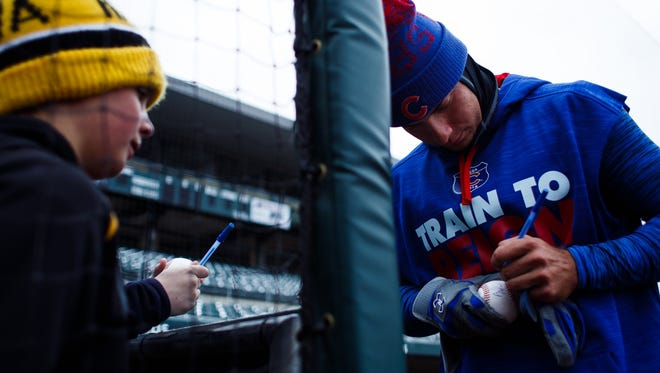 The Iowa Cubs Albert Almora Jr. signs an autograph during an open workout at Principal Park on Wednesday, April 06, 2016 in Des Moines.