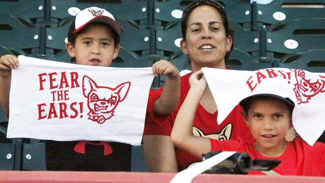 Kids hold up white rally towels Wednesday at Southwest University Park.