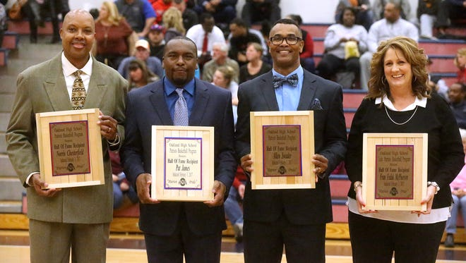 The Oakland Hall of Fame inductees were presented between the boys and girls Oakland vs. Stewarts Creek games on Friday, Feb. 3, 2017. (L to R) Norris Chesterfield, Pat James, Allen Swader and Fran Fedak McPherson.