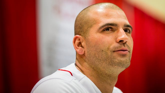 Cincinnati Reds first basemen Joey Votto autographs memorabilia at Redsfest at the Duke Energy Convention Center in downtown Cincinnati Friday, December 1, 2017.