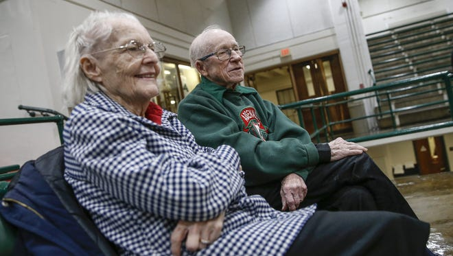 Ken and Joan Kenipe, who were both freshmen at Tech High School in 1946, watched as Tech faces off against McCutcheon in December. The Kenipes have missed only a handful of games since 1946.