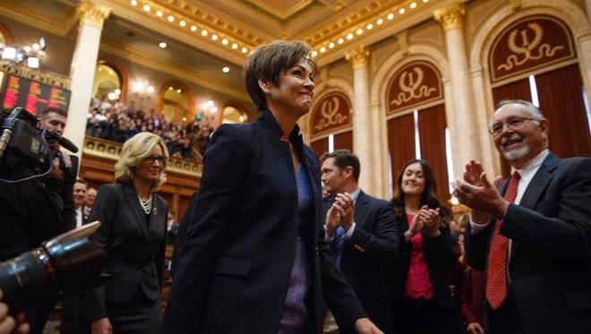 Lawmakers applaud Gov. Kim Reynolds on Jan. 9 before her first Condition of the State address to the Iowa Legislature at the State Capitol.