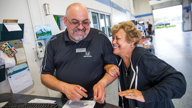 Nelson Catalan, a service consultant at Hare Honda in Avon, Ind., works with customer Darlene Lanane, of Indianapolis, on Thursday, May 3, 2018.