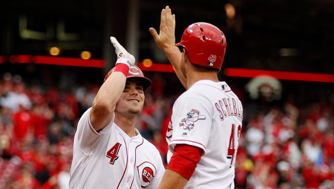 Scooter Gennett of the Reds celebrates a two-run homer he hit last week with Scott Schebler.