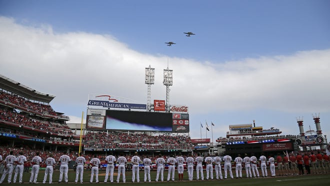 The U.S. Navy flies over during the National Anthem before the first inning of the MLB Opening Day game between the Cincinnati Reds and the Philadelphia Phillies at Great American Ball Park on Monday, April 4, 2016.