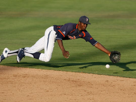 Pepperdine's Manny Jefferson comes up short as he dives for a grounder during the second inning of an NCAA college baseball tournament regional game against Cal Poly on Sunday, June 1, 2014, at Baggett Stadium at Cal Poly in San Luis Obispo, Calif. (AP Photo/Aaron Lambert)