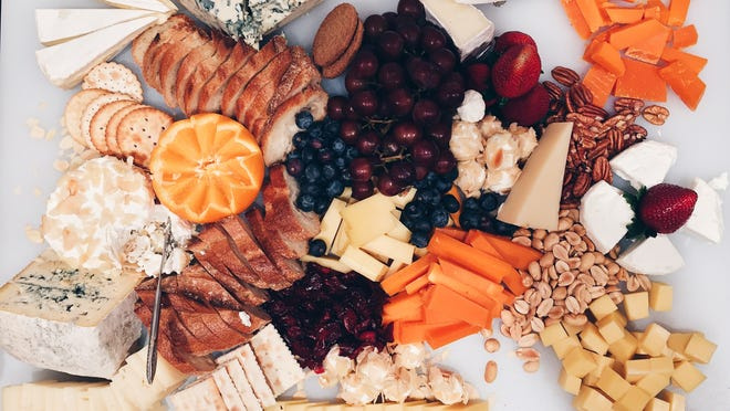 Offer fresh and dried fruits, a selection of nuts, crackers, pieces of bread, olives, honey and jams alongside the cheeses on your board.