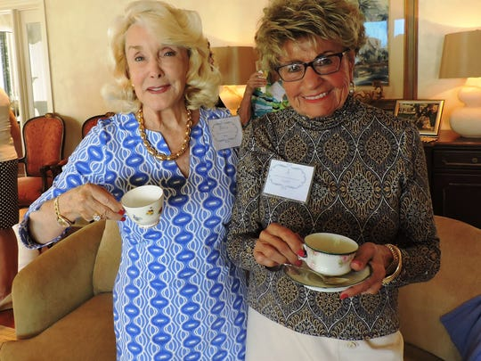Pat Borg, left, and Jo Covelli enjoy some tea at the unveiling of Mary's Archangels on March 12.