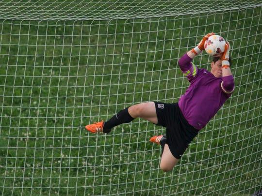 Bearden goalkeeper Andrew Wilkens blocks a Farragiut shot attempt. Farragut beat Bearden, 1-0, in the District 4-AAA Semi-Finals at Bearden on Wednesday, May 9, 2017.
