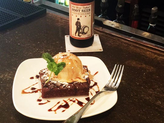 Brownie at Pure Eatery is infused with house Merlot, topped with Lick ice cream and drizzled with a syrup made from Not Your Father's Root Beer.