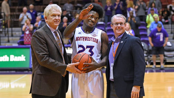 Northwestern State's Zeek Woodley poses with coach Mike McConanthy (left) and athletic director Greg Burke.