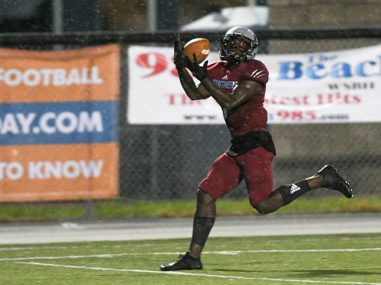 Romell Guerrier of Florida Tech hauls in a touchdown pass during Saturday's game at Panther Stadium