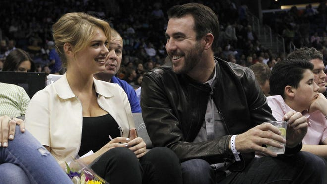 Feb 7, 2014; Orlando, FL, USA; Detroit Tigers pitcher Justin Verlander talks to actress Kate Upton during the game between the Orlando Magic and the Oklahoma City Thunder on Feb. 7, 2014, at Amway Center.