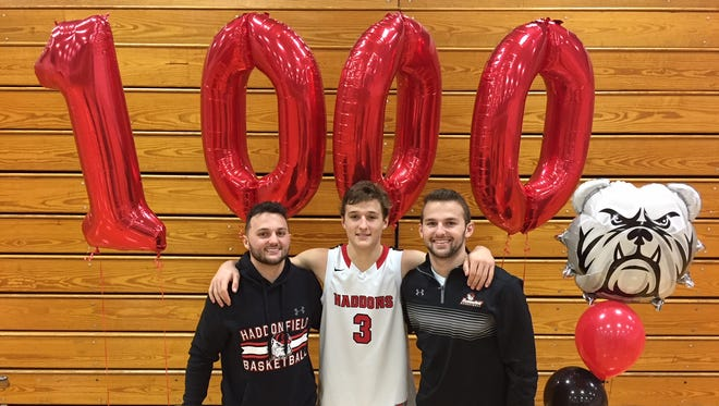 Haddonfield junior Mike Depersia, center, joined his brothers Rob, left, and Nick in the 1,000-point club on Saturday. They're just the fourth trio of brothers in state history to hi the milestone together.