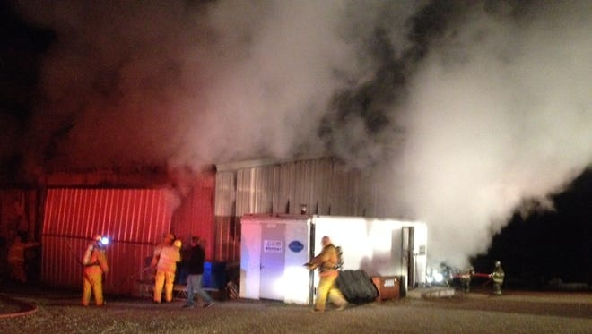 Firefighters work the scene of a major fire at Jennings Boat Docks & Lifts, located at 3915 AR Highway 101 on Thursday night.