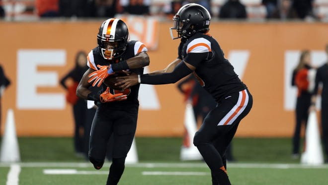 Nov 21, 2015; Corvallis, OR, USA; Oregon State Beavers quarterback Marcus McMaryion (3) hands the ball off to Oregon State Beavers wide receiver Victor Bolden (6) against the Washington Huskies at Reser Stadium.