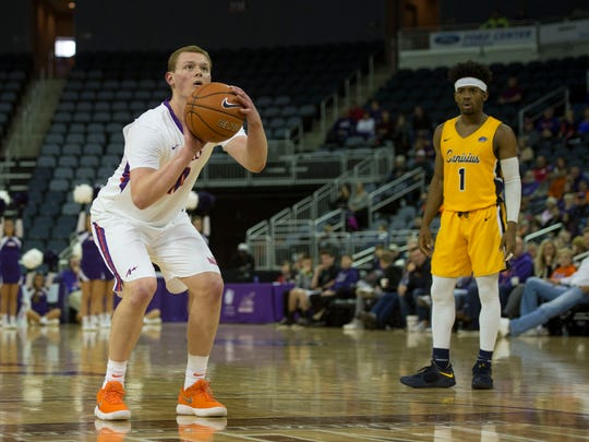 University of Evansville's Evan Kuhlman (10) takes a free throw against the Canisius Golden Griffins on Dec. 9. The Purple Aces won 65-58.