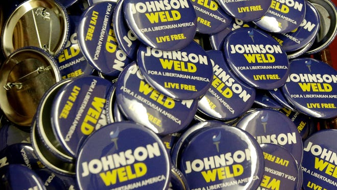 Campaign buttons for Libertarian presidential candidate Gary Johnson and vice presidential candidate Bill Weld at the National Libertarian Party Convention, May 27, in Orlando, Fla.