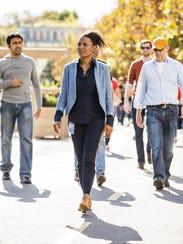 Maxine Williams walks on the Facebook campus in Menlo
