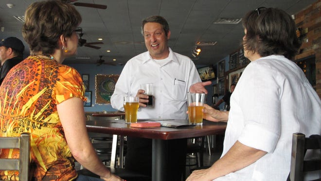 AP Libertarian gubernatorial candidate Adrian Wyllie talks with voters while campaigning in Jacksonville Beach in August. In this Aug. 16, 2014 photo, Libertarian gubernatorial candidate Adrian Wyllie talks with voters while campaigning in Jacksonville Beach, Fla. Wyllie senses that voters are frustrated with their choices in this yearâ??s governorâ??s race and is hoping they seem him as a better alternative. The campaign between Republican Gov. Rick Scott and Democrat Charlie Crist has been extremely negative and Wyllie is polling better than third-party candidates have in past years.(AP Photo/Brendan Farrington)