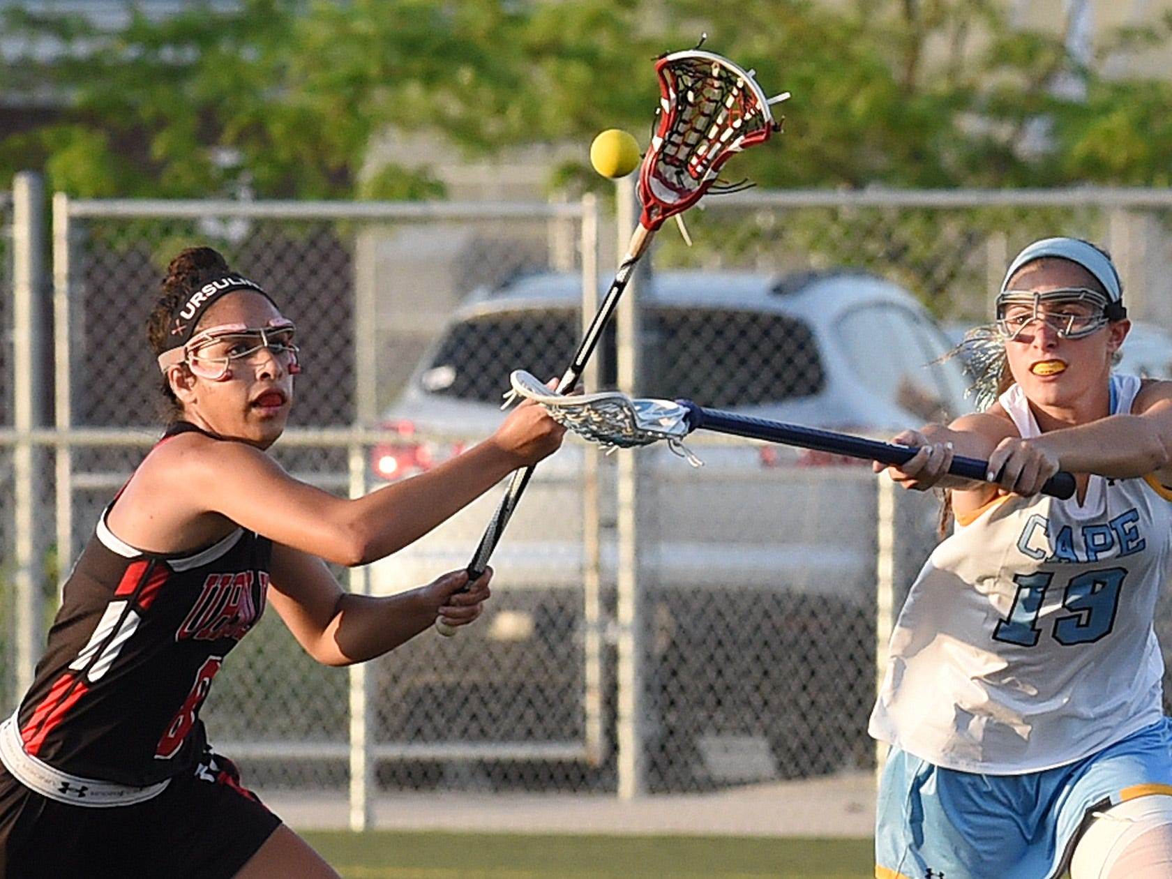 Cape Henlopen's Alison Palmer and Ursuline's Emily Blaszkow go after the ball in Cape's 17-4 win on Tuesday.