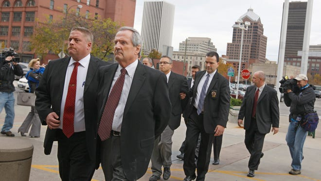 File photo 2013: Robert Wiesner, front right, husband of Monroe County Executive Maggie Brooks and former Monroe County Water Authority security director, is one of four escorted from the Attorney General's office to the Rochester Police Department.