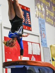 Sophomore Ava Farquhar competed on balance beam and