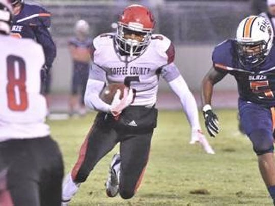 Coffee County's Alontae Taylor runs the ball on Friday, Sept. 1, 2017 against Blackman.