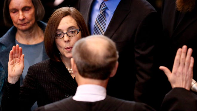 Kate Brown is sworn in as the 38th Oregon governor at Oregon State Capitol in Salem on Wednesday, Feb. 18, 2015.