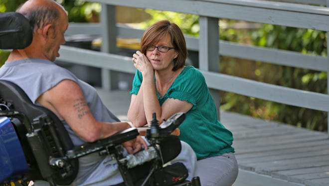 Brenda Defler (right) talks with Don, for whom she is a guardian, on Aug. 7, 2015. She and John Defler, both with Adult Protective Services Unit 11, were driving around to check out reports of possible endangered adults and to see other clients for whom they are guardians.